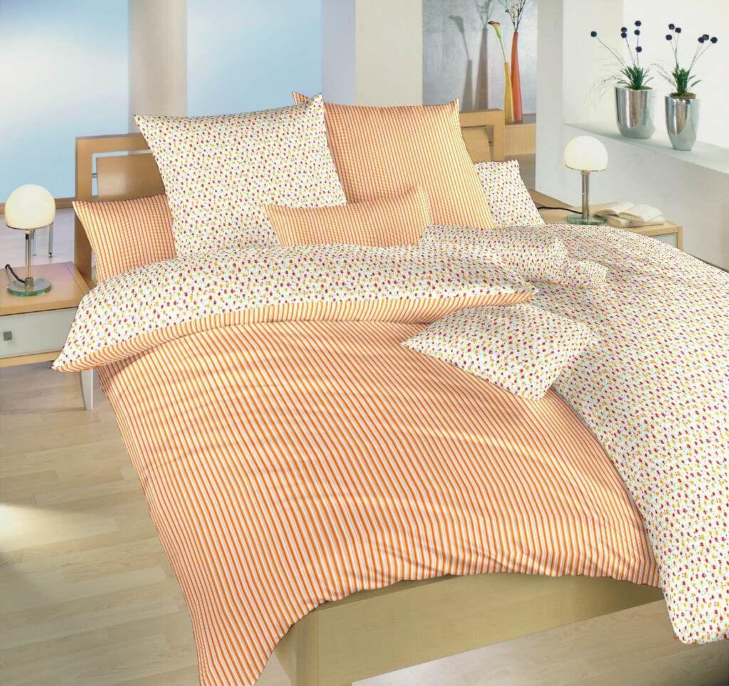 Bavlnené obojstranné obliečky s motívom prúžkov a kvetín oranžovej farby Dadka
